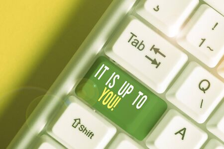 Text sign showing It Is Up To You. Business photo showcasing Used to tell a demonstrating that they are the one to decide White pc keyboard with empty note paper above white background key copy space