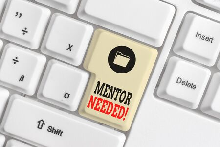 Text sign showing Mentor Needed. Business photo showcasing Employee training under senior assigned act as advisor White pc keyboard with empty note paper above white background key copy space 版權商用圖片