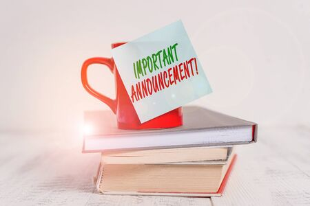 Conceptual hand writing showing Important Announcement. Concept meaning spoken statement that tells showing about something Coffee cup sticky note stacked books retro old retro wooden table