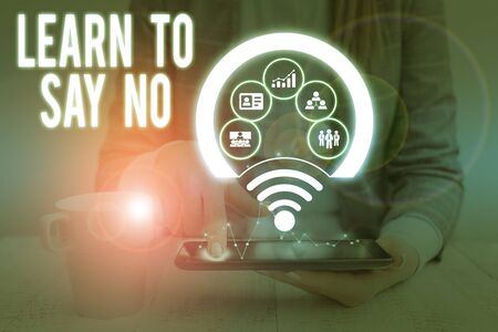 Writing note showing Learn To Say No. Business concept for decline or refuse few things before you destroy yourself Picture photo network scheme with modern smart device Stock Photo
