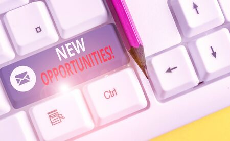 Writing note showing New Opportunities. Business concept for exchange views condition favorable for attainment goal White pc keyboard with note paper above the white background
