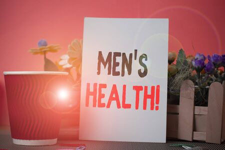 Word writing text Men S Health. Business photo showcasing state of complete physical mental and social well being by analysis Flowers and stationary plus plain sheet with paper big cup above a table
