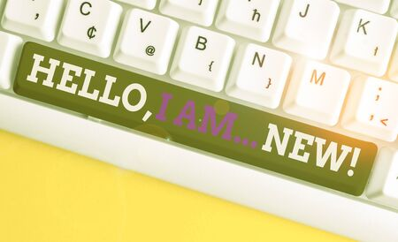 Conceptual hand writing showing Hello I Am New. Concept meaning introducing oneself in a group as fresh worker or student White pc keyboard with note paper above the white background