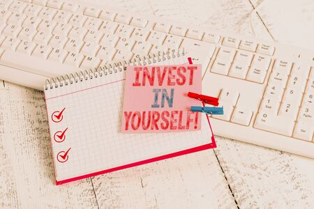 Writing note showing Invest In Yourself. Business concept for learn new things or materials thus making your lot better notebook reminder clothespin with pinned sheet light wooden Stock Photo