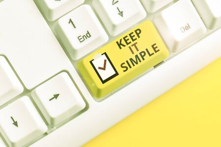 Text sign showing Keep It Simple. Business photo showcasing to make something easy to understand and not in fancy way White pc keyboard with empty note paper above white background key copy space
