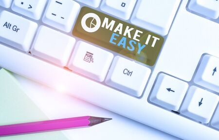 Conceptual hand writing showing Make It Easy. Concept meaning Smart approach Effortless Free from worries or difficulties White pc keyboard with note paper above the white background