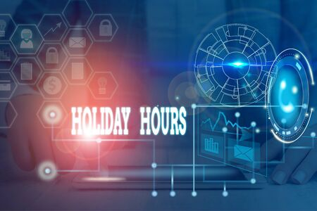 Writing note showing Holiday Hours. Business concept for employee receives twice their normal pay for all hours Picture photo network scheme with modern smart device