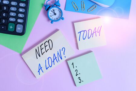 Text sign showing Need A Loan Question. Business photo showcasing asking he need money expected paid back with interest Wire mouse portable calculator notepads paper sheets clips color background Stock fotó - 132726627