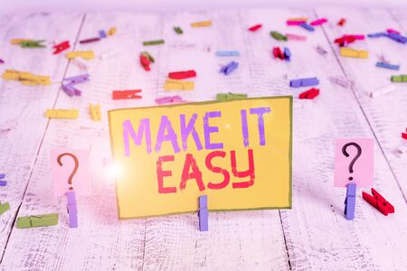 Text sign showing Make It Easy. Business photo text Smart approach Effortless Free from worries or difficulties Scribbled and crumbling sheet with paper clips placed on the wooden table