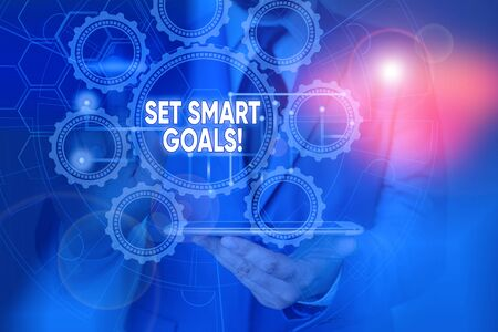 Conceptual hand writing showing Set Smart Goals. Concept meaning list to clarify your ideas focus efforts use time wisely Picture photo network scheme with modern smart device