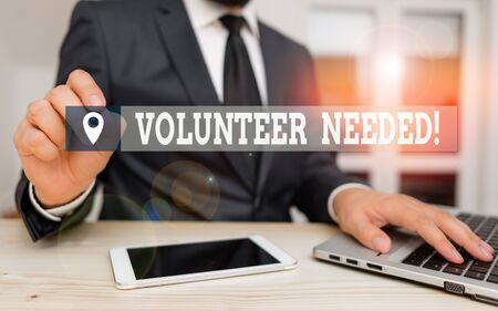 Handwriting text writing Volunteer Needed. Conceptual photo asking demonstrating to work for organization without being paid Male human wear formal clothes present presentation use hi tech smartphone Stock fotó