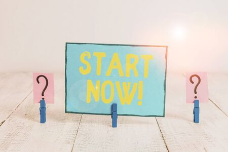 Text sign showing Start Now. Business photo text do not hesitate get working or doing stuff right away Scribbled and crumbling sheet with paper clips placed on the wooden table