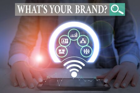 Writing note showing What S Your Brand Question. Business concept for asking about product does or what you communicate Picture photo network scheme with modern smart device
