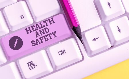 Text sign showing Health And Safety question. Business photo text regulations and procedures intended to prevent accident White pc keyboard with empty note paper above white background key copy space Reklamní fotografie