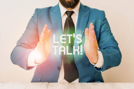 Word writing text Let S Is Talk. Business photo showcasing suggesting in the beginning of a conversation on the topic Man holds empty paper with copy space in front of him Space Stock fotó