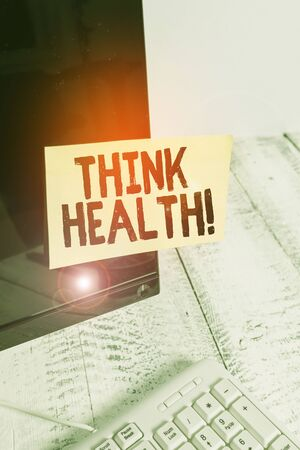 Word writing text Think Health. Business photo showcasing state of complete physical mental and social well being Notation paper taped to black computer monitor screen near white keyboard