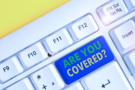 Text sign showing Are You Covered Question. Business photo showcasing asking showing if they had insurance in work or life White pc keyboard with empty note paper above white background key copy space Zdjęcie Seryjne