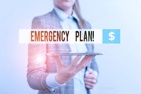 Conceptual hand writing showing Emergency Plan. Concept meaning actions developed to mitigate damage of potential events Business concept with mobile phone and business woman
