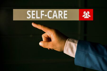 Conceptual hand writing showing Self Care. Concept meaning practice of taking action to preserve or improve ones own health Isolated hand pointing with finger. Business concept