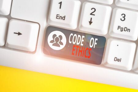 Text sign showing Code Of Ethics. Business photo showcasing basic guide for professional conduct and imposes duties White pc keyboard with empty note paper above white background key copy space Standard-Bild