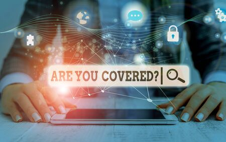 Conceptual hand writing showing Are You Covered Question. Concept meaning asking showing if they had insurance in work or life Picture photo network scheme with modern smart device