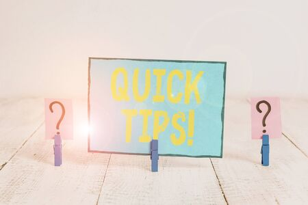 Text sign showing Quick Tips. Business photo text small but particularly useful piece of practical advice Scribbled and crumbling sheet with paper clips placed on the wooden table