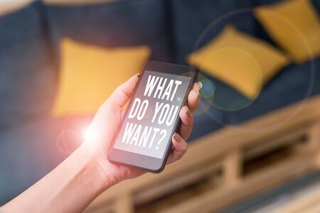 Writing note showing What Do You Want Question. Business concept for say or write in order to ask demonstrating about something woman using smartphone and technological devices inside the home