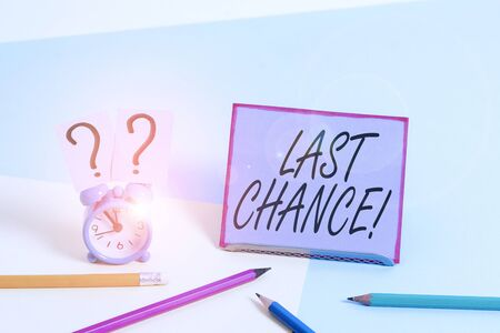 Conceptual hand writing showing Last Chance. Concept meaning final opportunity to achieve or acquire something you want Mini size alarm clock beside stationary on pastel backdrop