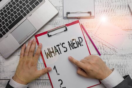 Text sign showing What S New Question. Business photo text when you ask someone about his current live events actions Hand hold writing equipment tool near modern high technology laptop device 版權商用圖片 - 133024774