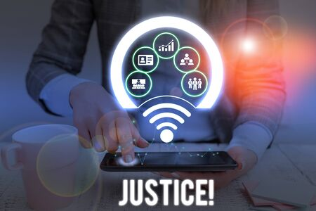 Conceptual hand writing showing Justice. Concept meaning impartial adjustment of conflicting claims or assignments Picture photo network scheme with modern smart device