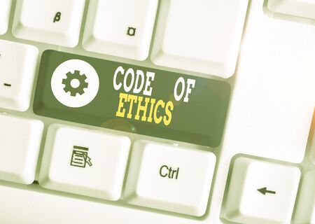 Word writing text Code Of Ethics. Business photo showcasing basic guide for professional conduct and imposes duties White pc keyboard with empty note paper above white background key copy space 스톡 콘텐츠