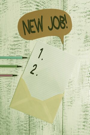 Conceptual hand writing showing New Job. Concept meaning recently having paid position of regular employment Envelope speech bubble ballpoints lying wooden retro background