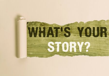 Writing note showing What S Is Your Story question. Business concept for being asked by someone about my own journey from beginning till now Cardboard which is torn placed above a wooden classic table Standard-Bild