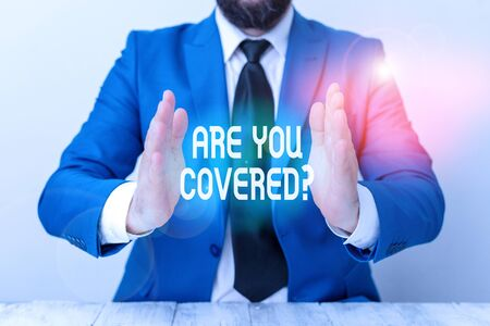 Word writing text Are You Covered Question. Business photo showcasing asking showing if they had insurance in work or life Man holds empty paper with copy space in front of him Space Zdjęcie Seryjne