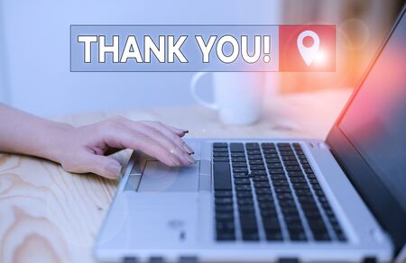 Conceptual hand writing showing Thank You. Concept meaning polite expression used when acknowledging gift service compliment woman with laptop smartphone and office supplies technology
