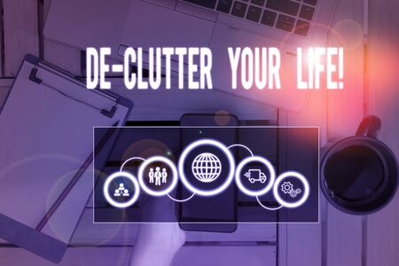 Writing note showing De Clutter Your Life. Business concept for remove unnecessary items from untidy or overcrowded places Picture photo network scheme with modern smart device
