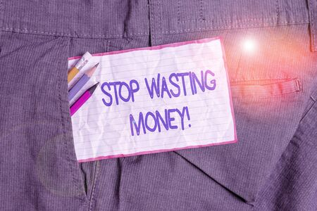 Text sign showing Stop Wasting Money. Business photo text advicing demonstrating or group to start saving and use it wisely Writing equipment and white note paper inside pocket of man work trousers