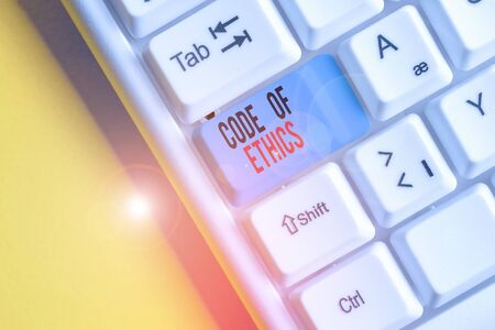 Handwriting text writing Code Of Ethics. Conceptual photo basic guide for professional conduct and imposes duties White pc keyboard with empty note paper above white background key copy space