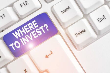 Word writing text Where To Invest Question. Business photo showcasing asking about where put money into financial schemes or shares White pc keyboard with empty note paper above white background key copy space Banco de Imagens