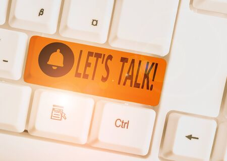 Text sign showing Let S Talk. Business photo text they are suggesting beginning conversation on specific topic White pc keyboard with empty note paper above white background key copy space Stock fotó