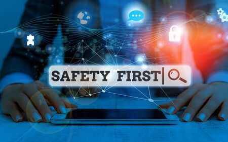 Conceptual hand writing showing Safety First. Concept meaning used to say that the most important thing is to be safe Picture photo network scheme with modern smart device