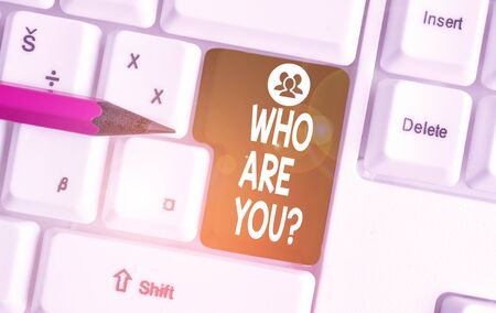 Handwriting text writing Who Are You question. Conceptual photo asking about demonstrating identity or demonstratingal information White pc keyboard with empty note paper above white background key copy space