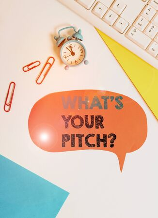 Text sign showing What S Is Your Pitch question. Business photo text asking about property of sound or music tone Flat lay above table with copy space on the bubble paper with clock and paper clips