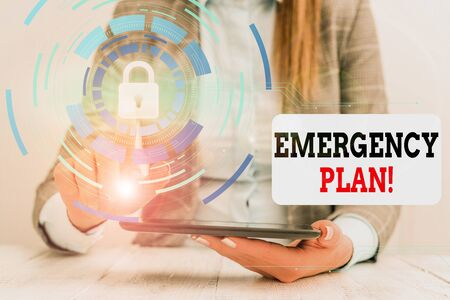 Word writing text Emergency Plan. Business photo showcasing actions developed to mitigate damage of potential events Female human wear formal work suit presenting presentation use smart device 版權商用圖片