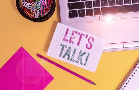 Handwriting text Let S Is Talk. Conceptual photo suggesting in the beginning of a conversation on the topic Laptop pencil sheet clips container spiral envelope colored background