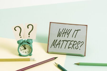 Conceptual hand writing showing Why It Matters Question. Concept meaning most important thing to be done when involved in situation Mini size alarm clock beside stationary on pastel backdrop