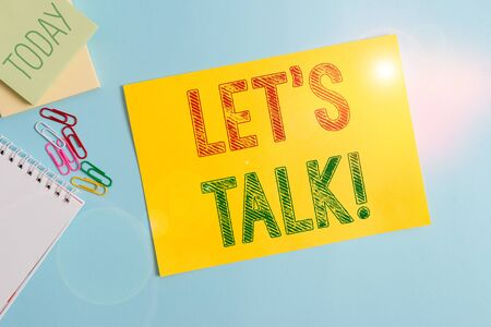 Conceptual hand writing showing Let S Is Talk. Concept meaning suggesting in the beginning of a conversation on the topic Cardboard and writing equipment placed above pastel backdrop