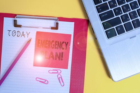 Conceptual hand writing showing Emergency Plan. Concept meaning actions developed to mitigate damage of potential events Metallic laptop clipboard paper sheet pencil colored background 版權商用圖片