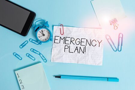 Handwriting text Emergency Plan. Conceptual photo actions developed to mitigate damage of potential events Alarm clock clips notepad smartphone rubber band marker colored background 版權商用圖片