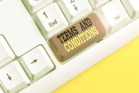 Conceptual hand writing showing Terms And Conditions. Concept meaning rules that apply to fulfilling a particular contract White pc keyboard with note paper above the white background Reklamní fotografie